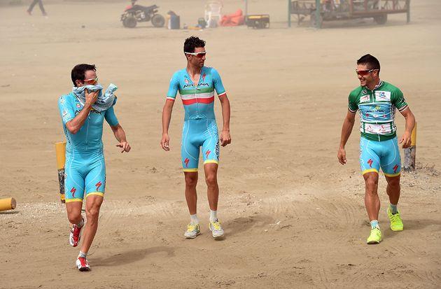 Astana riders in a sandstorm.