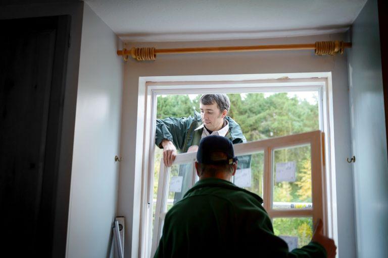 men installing new windows