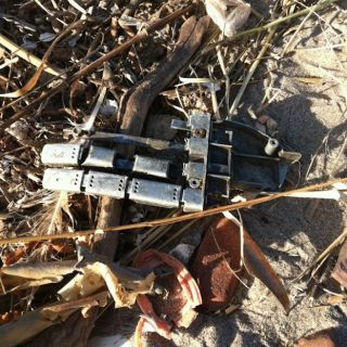 Robot hand on beach