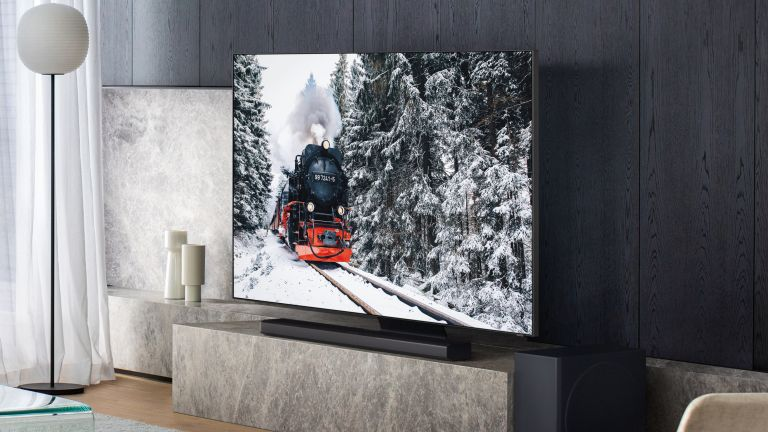 TV with a soundbar in a modernist home sitting on a marble bench