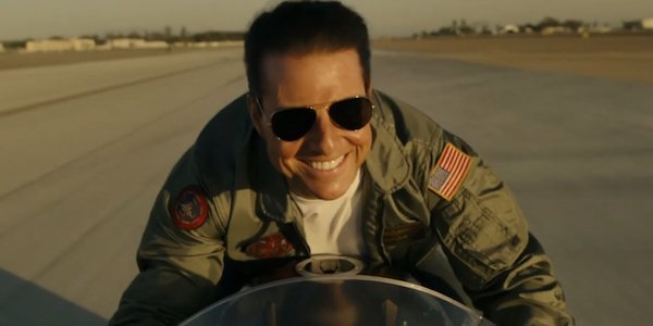 """Tom Cruise happy on a motorcycle as Pete """"Maverick"""" Mitchell in Top Gun: Maverick"""