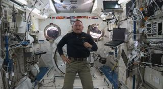 "Barry ""Butch"" Wilmore, commander of the International Space Station, sends a Thanksgiving message to Earth. This image is a still from a NASA video published on Nov. 24, 2014."