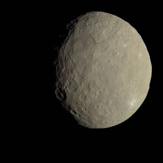 This view of Ceres from NASA's Dawn spacecraft shows what the dwarf planet would look like to the human eye. A new study suggests the rocky world's surface has wobbled in the past.