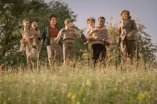 First Look! Jenny Agutter as Bobbie Waterbury (far right) and Sheridan Smith (third from left, in hat) as Bobbie's daughter Annie in The Railway Children Return.