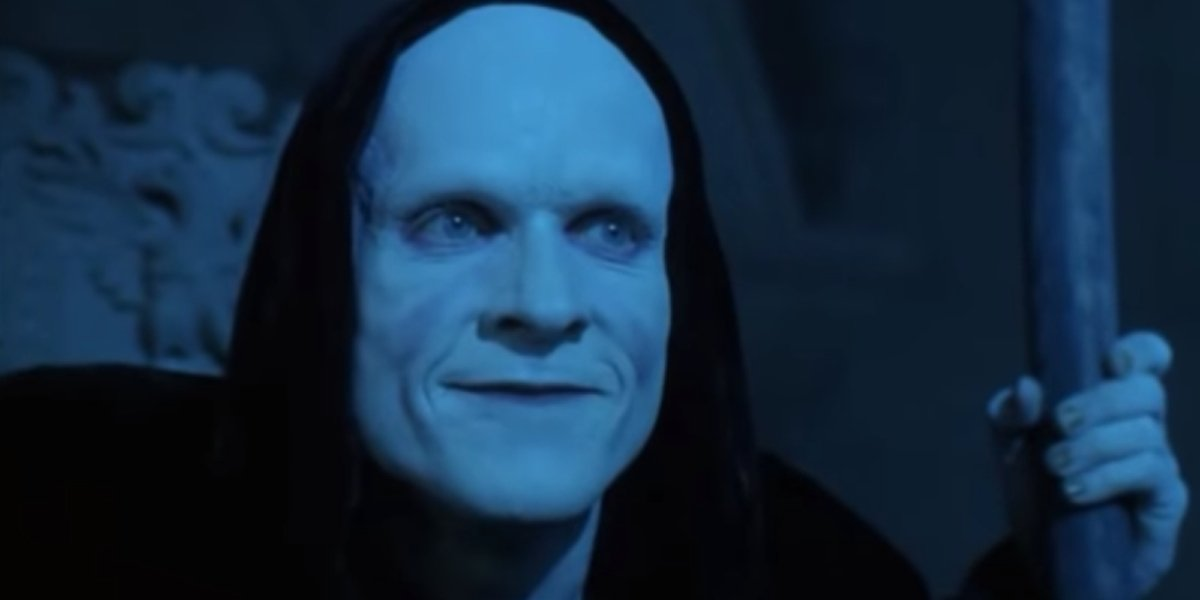 Bill & Ted's Bogus Journey Death holds his scythe with a smile