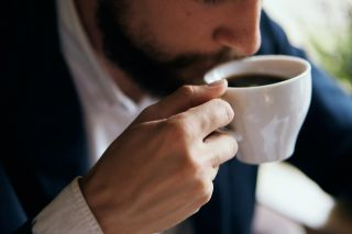 A man drinking coffee.