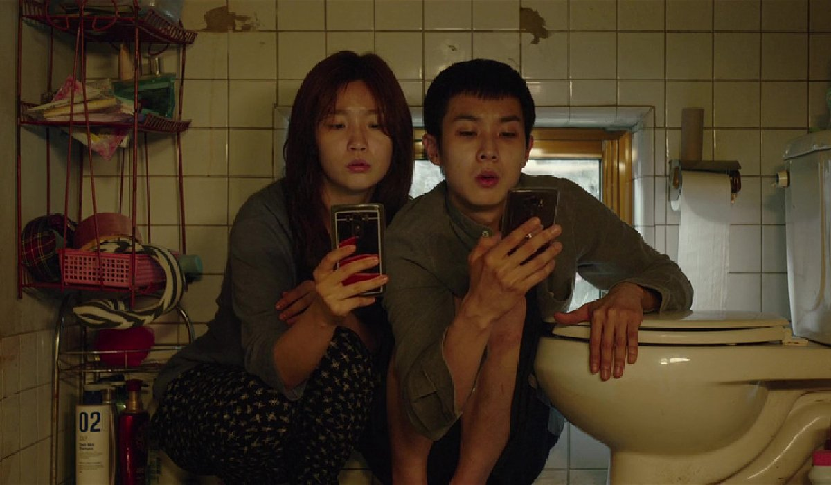 Parasite The Kim children check their cell phones in the bathroom