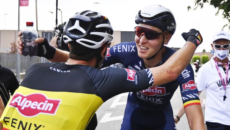 Tim Merlier celebrates victory on stage two of the Giro d'Italia 2021