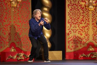 Alan Davies attempts to mime something for the Taskmaster in the live studio task — but what?