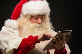 Santa with a tablet.