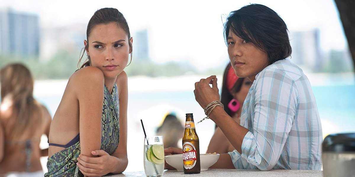 Gal Gadot and Sung Kang in Fast Five