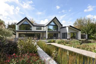 a self build by allan corfield architects with an air source heat pump