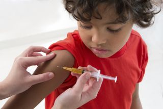 A child receives a vaccination.
