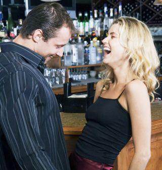 couple flirting, men overestimate women's sexual interest.