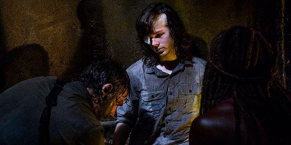 Rick mourning Carl's bite