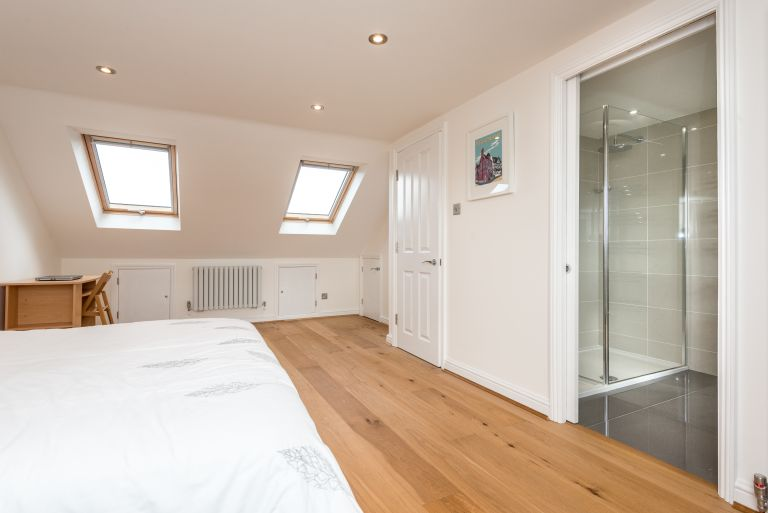 Econoloft loft conversion with sliding doors to bathroom