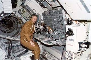 Skylab 3 science pilot Owen Garriott is seen stationed at the Apollo Telescope Mount console aboard the Skylab space station.