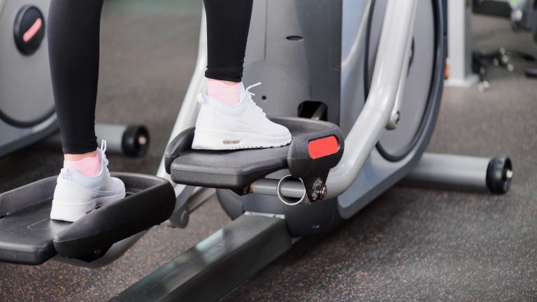 Best cross trainers: Shutterstock image of someone on a cross trainer