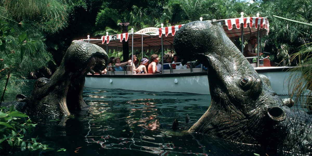 Disneyland visitors ride one of the Jungle Cruise boats.