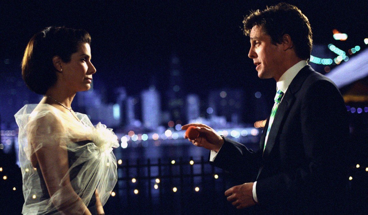 Two Weeks Notice Sandra Bullock and Hugh Grant share a moment on the water