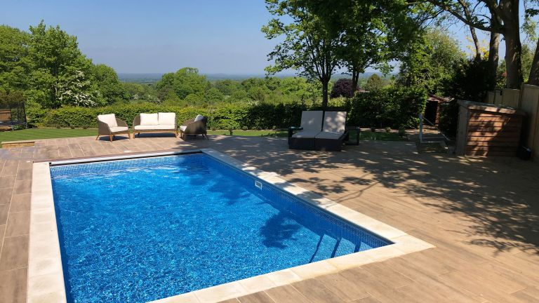 pool maintenance: outdoor pool with decking by Home Counties Pools & Hot Tubs
