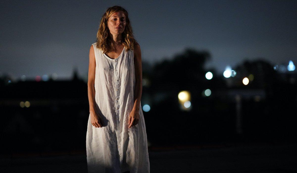 Sienna Miller as Adrienne in Wander Darkly