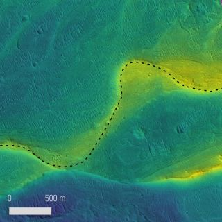 Marked photo of a preserved river channel on Mars, taken by NASA's Mars Reconnaissance Orbiter, with color overlaid to indicate elevation (blue is low, yellow is high.) The range of elevation in the scene is about 115 feet (35 meters).