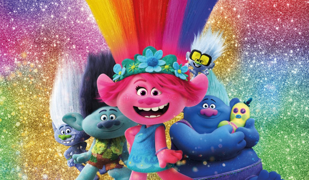 Trolls World Tour Poppy and friends in front of a glittery background