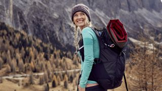 what to wear hiking: hiker smiling