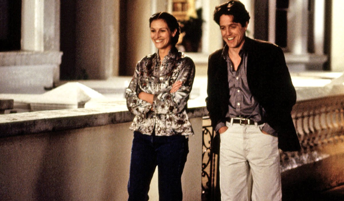 Julia Roberts and Hugh Grant go on a charming walk in Notting Hill.