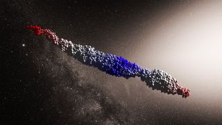 This simulation depicts the interstellar object 'Oumuamua as a mass of fragments forced into an elongated shape by stellar tidal forces.
