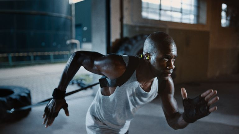 Man training whilst wearing the Sennheiser CX Sport in-ear headphones