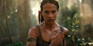 Alicia Vikander's Lara Croft running in the jungle in Tomb Raider