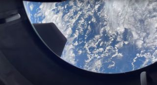 Earth as seen through the cupola window of SpaceX's Crew Dragon vehicle Resilience on the Inspiration4 mission.
