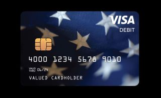 Visa debit card with white stars on blue background.