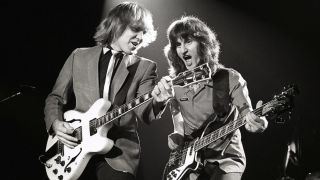 Rush's Alex Lifeson and Geddy Lee on stage in 1981