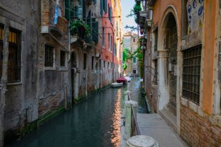 A narrow canal in Venice, Italy in June 2019.