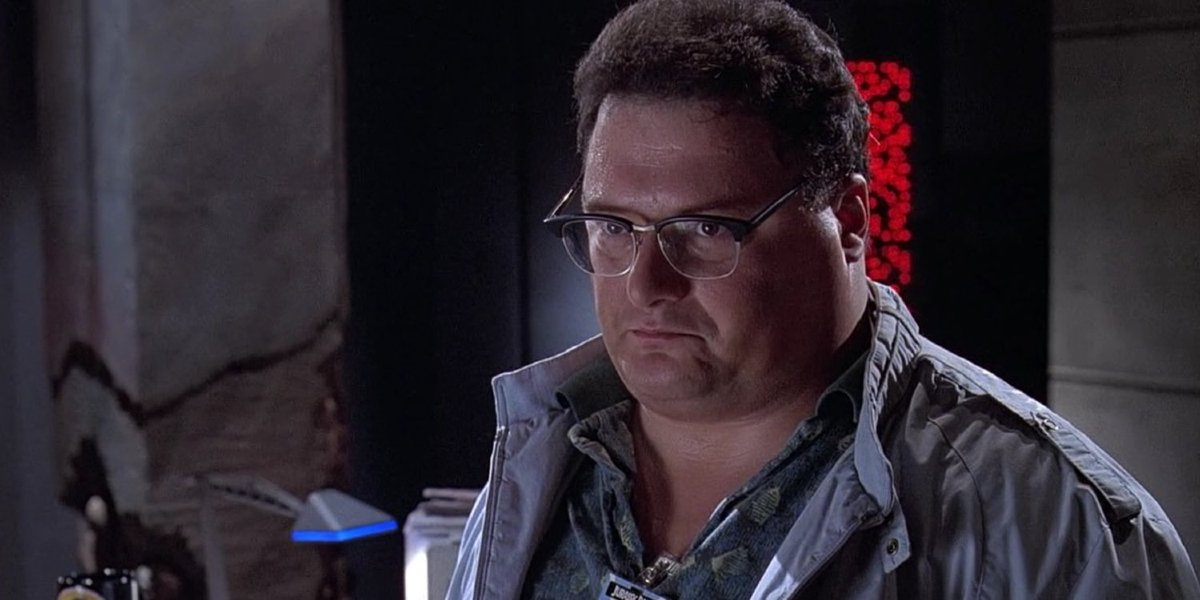 Jurassic Park Nedry looks suspicious at his console