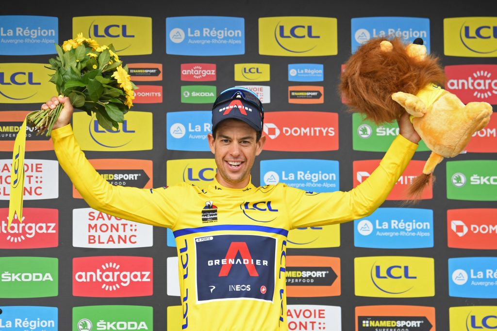 Team Ineos Richie Porte of Australia celebrates his overall leaders yellow jersey on the podium at the end of the eighth stage on the final day of the 73rd edition of the Criterium du Dauphine cycling race a 147km between La LechereLesBains and Les Gets on June 6 2021 Photo by Alain JOCARD AFP Photo by ALAIN JOCARDAFP via Getty Images