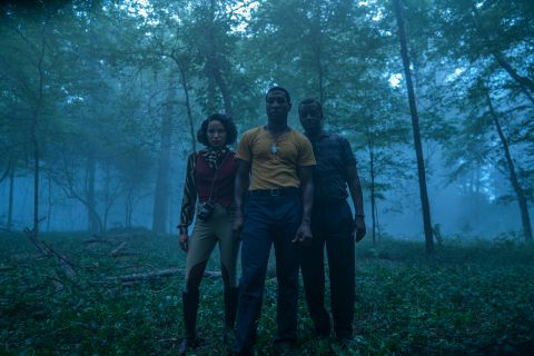 Atticus (Jonathan Majors), George (Courtney B. Vance) and Leti (Jurnee Smollett) in the woods in Lovecraft Country.