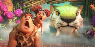 The Croods 2: A New Age the kids look shocked next to their family pet
