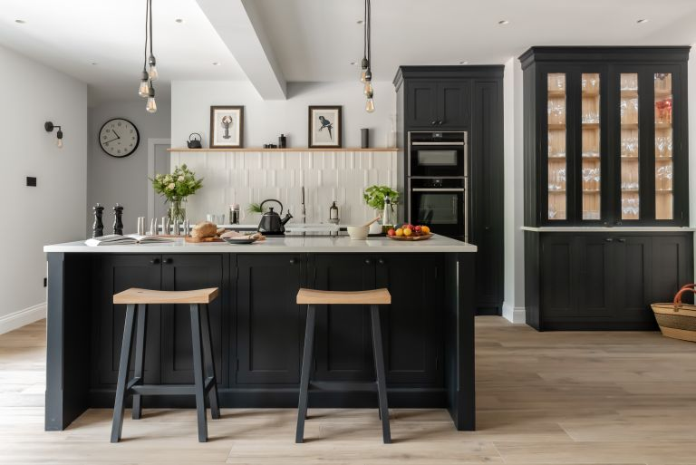 Kitchen flooring ideas with porcelain wood flooring and black cabinetry.