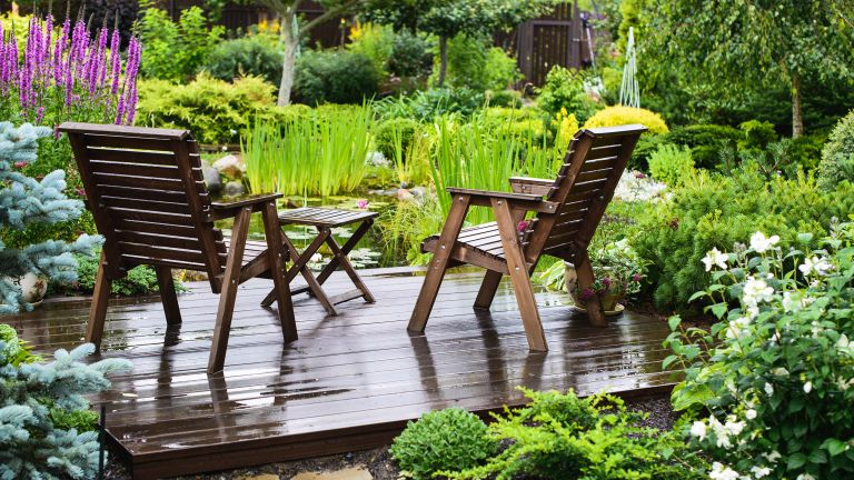 how much does decking cost: two chairs on deck in garden