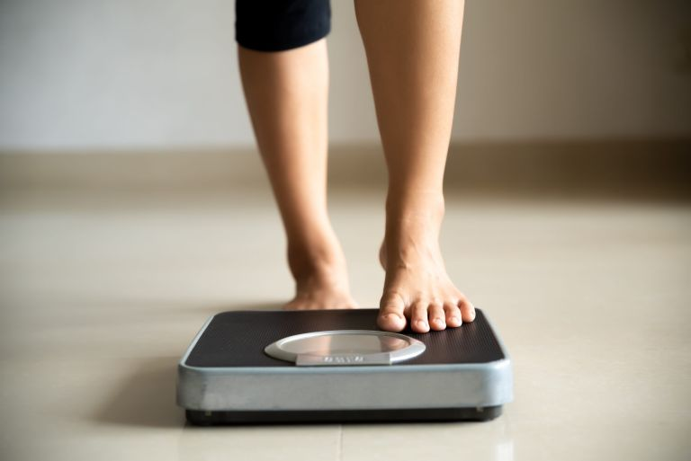 woman getting onto the scales