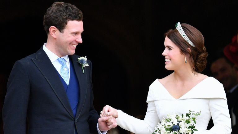Jack Brooksbank and Princess Eugenie leave St George's Chapel after their wedding ceremony on October 12, 2018 in Windsor