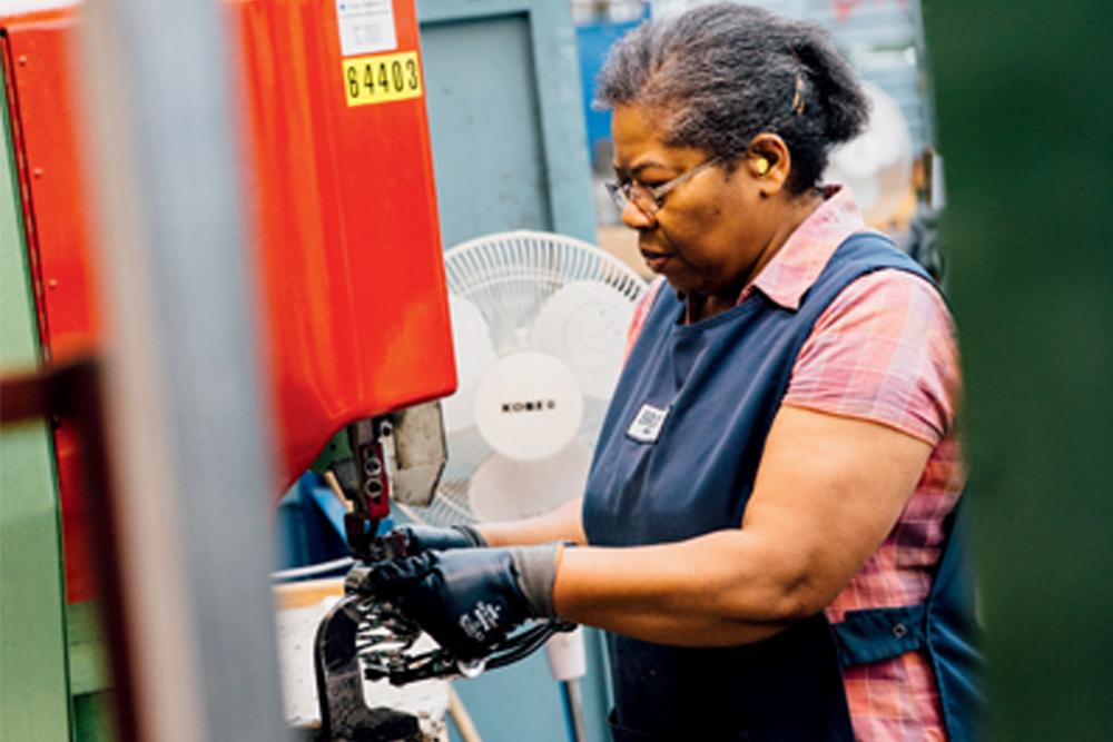 72b673d5853 Sonia Thomas, Brooks's longest serving employee, operating a riveting  machine