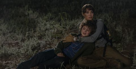Hannah Faber (Angelina Jolie) comforts young Connor Casserly as they run from a pair of assassing who want to kill him in 'Those Who Wish Me Dead'.