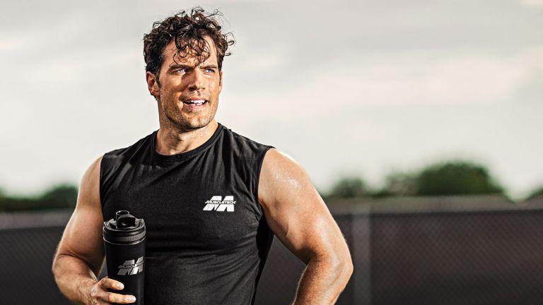 Henry Cavill having a Muscletech shake after a workout