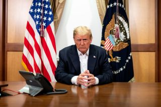 Donald Trump Sunday, Oct. 4, 2020, in his conference room at Walter Reed National Military Medical Center in Bethesda, Md.