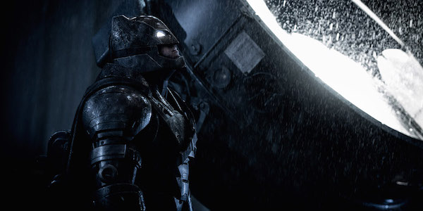 Armored Batman next to Bat-Signal in Batman v Superman